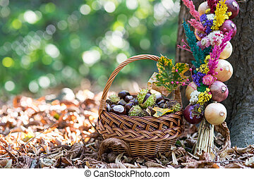 many chestnuts in a basket and decoration with onions