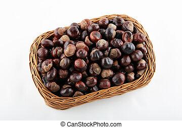 Many chestnuts in crib on white background