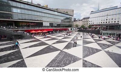 Many citizens walk by Sergels torg square in Stockholm