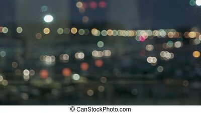 Many city lights blurred on night panorama