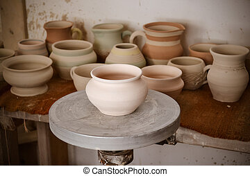 many clay pot is on the table