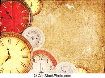 Many clocks on a paper background