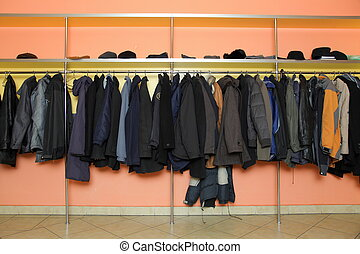 Many clothes in cloakroom - Locker room many clothes in ...