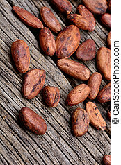 Many cocoa beans on wooden table