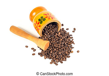 Many coffee beans in a wooden mortar with authentic pattern and