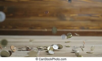 Many Coins Falling Slow Motion