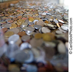 Many coins from different countries of the world.