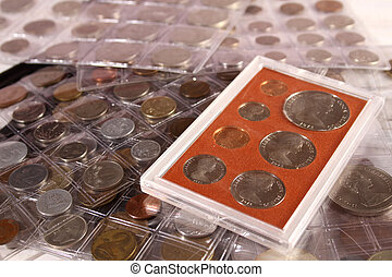 Many coins of different countries and times. Numismatics