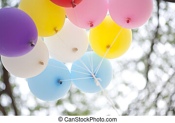 many colored balloons forming a bright background wallpaper...