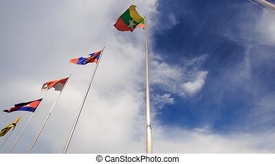 Many-colored Banners Flap on Flagstaffs Blue Sky - many-...