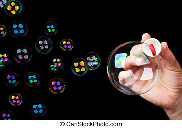 many colored bubbles isolated on a black background