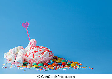 Many colored candy - Many colored sweets on blue background