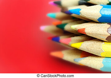 Many colored pencil on red background