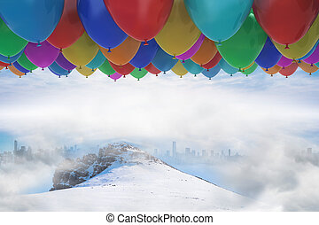 Many colorful balloons above snow