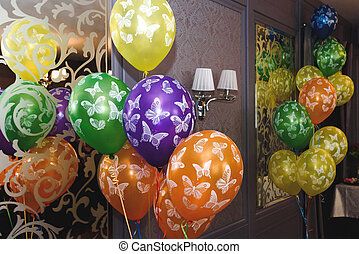 many colorful balloons with butterflies, decoration in restaurant for children's birthday party