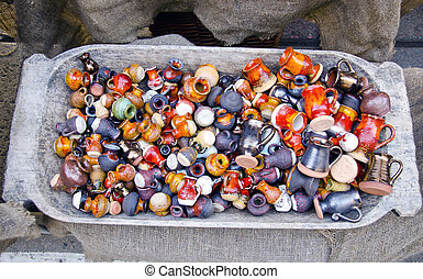 many colorful beautiful ceramics jugs in market
