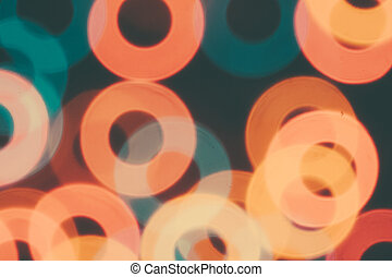 Many colorful circles on a dark background.