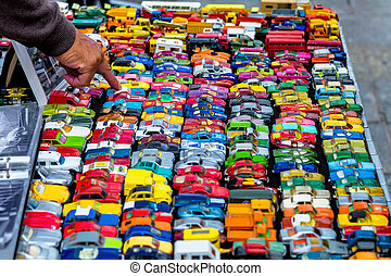 many colorful toy cars, a symbol of childhood hobby,...