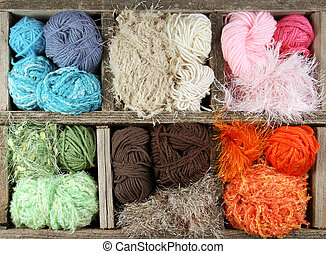 many colorful yarns in wooden box - many colorful yarn balls...
