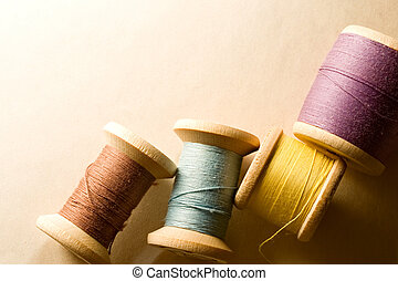 Many-coloured wooden bobbins
