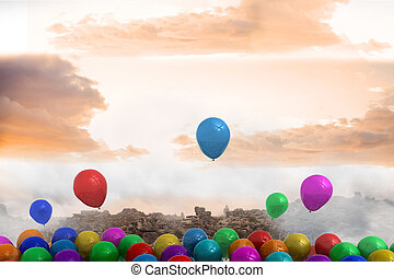 Many colourful balloons above landscape
