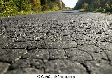 cracks on asphalt in a sunny day