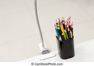 Many crayons with different colors. Back to school. Colored pencils in an glass