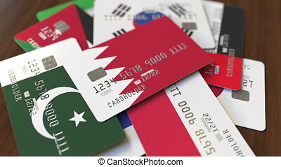 Many credit cards with different flags, emphasized bank card...