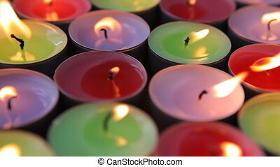 Many decorative candles burning. - Many decorative candles...