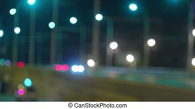 Many defocused street lights on overpass in the night - Many...