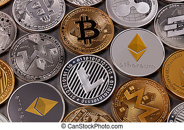 Gold and silver coins, LTC, ETH, BTC, XMR, XRP. A pattern from different coins of virtual currency on a dark background. Cryptocurrency and blockchain concept. Top view