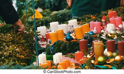 Many different multicolored candles as decorations for...
