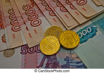 Many different Russian banknotes and coins