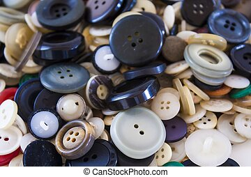 Many different sized colored and shaped buttons, pile