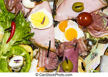 Many different Spanish tapas appetizers on wooden background