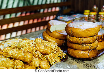many different types of cheese on the table