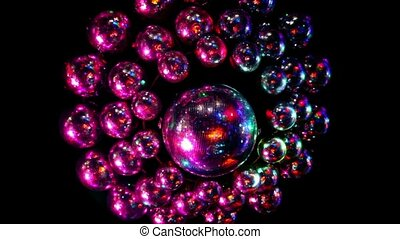 Many discoballs under ceiling light is reflected from...
