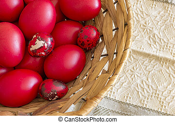 Many Easter red colored eggs in the basket on the table. Top view
