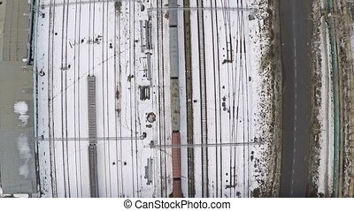 Many electrified railroad tracks and switches in winter. Aerial shot from above