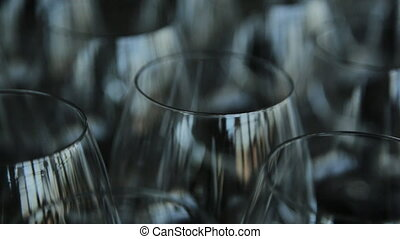 Many empty crystal wine glasses stands on table.