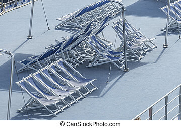 Many empty deck chair on a passenger ship