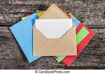 many envelopes with white paper