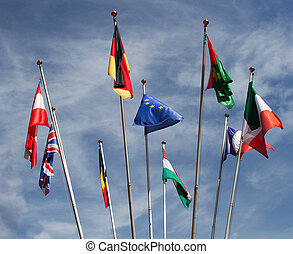 Many europeans flags in the wind against the sky