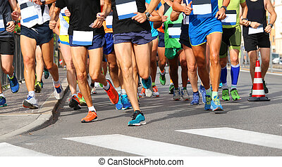 runners run at finish line during race in the city