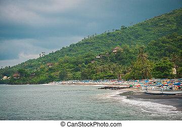 Many fishing boats on the ocean shore