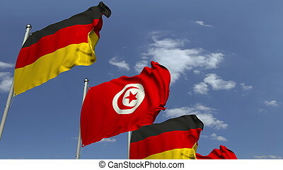 Many flags of Tunisia and Germany, 3D rendering