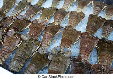 Many fresh crayfish at seafood market