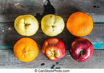 Many fruits on a wooden