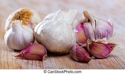 Many garlic on a wooden surface. High quality photo