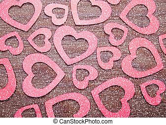 many glittering hearts on wood